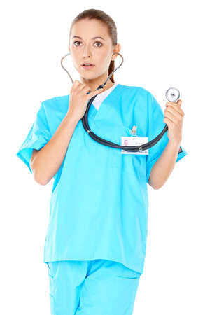 phisician: Friendly confident female doctor or nurse with a beautiful smile in green scrubs with a stethoscope isolated on white Stock Photo