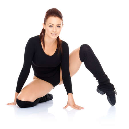 bodysuit: Athletic fit woman working out doing exercises stretching and toning her muscles to increase mobility and suppleness  on a white reflective background