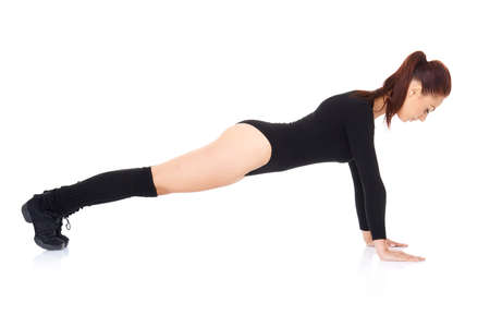 bodysuit: Athletic young woman working out in a leotard doing press ups balanced on her arms and toes over a white background  side view