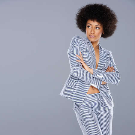 beautiful navel women: Beautiful glamorous Afro-American woman in a stylish tailored striped slack suit standing looking at her right