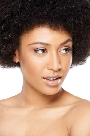 raised eyebrow: Close up head and shoulders portrait of a beautiful speculative African American woman looking off to the side with a raised eyebrow and watchful expression with parted lips Stock Photo