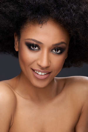 afro hairdo: Beautiful glamorous Afro-American woman with a frizzy afro hairdo and bare shoulders