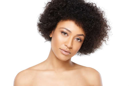 bare shoulders: Beautiful serious young African American woman with bare shoulders looking at the camera with her head tilted and a serious expression, isolated on white Stock Photo