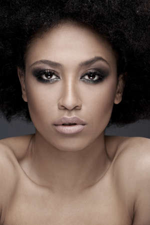 bare shoulders: Seductive African American woman with parted lips and bare shoulders looking at the camera with a seductive expression, close up face portrait