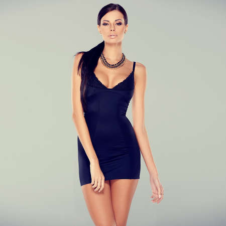 Adorable glamour woman in sexy dress posing isolated Stockfoto