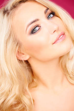 head tilted: Seductive beautiful young blond woman with her head tilted back looking sideways at the camera Stock Photo