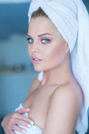 hair wrapped up: Close Up of Young Woman Wearing White Bath Towel with Hair Wrapped and Looking Sexy