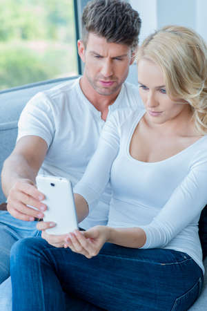 consternation: Couple reading a text message with consternation Stock Photo