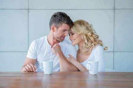 20 24: Loving couple enjoying coffee together Stock Photo