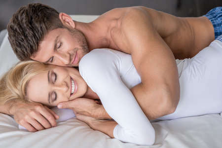 romance bed: Smiling Middle Age Lovers Lying in Bed So Sweet