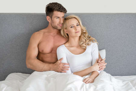 20 24: Middle Age Romantic Couple on Bed Fashion Shoot
