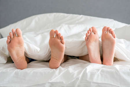 20 24: Close up Partners Soles on White Bed