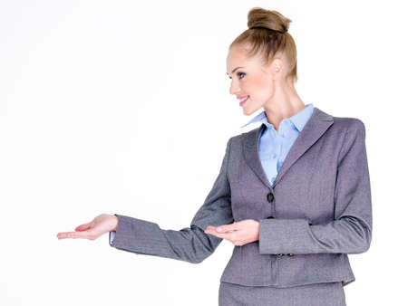 uniform attire: Businesswoman Holding Hands Out to Side Stock Photo
