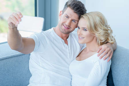20 24: Attractive couple posing for a selfie Stock Photo