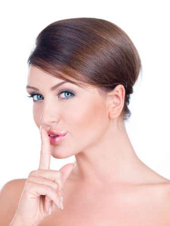 shushing: Young woman making a shushing gesture