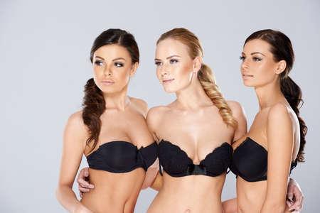 Three sexy woman posing in black lingerie Foto de archivo