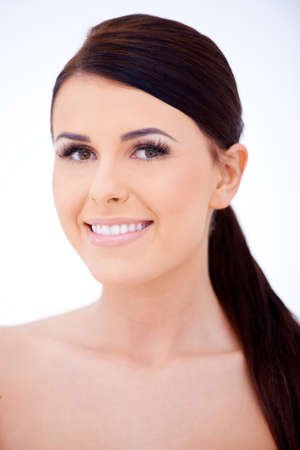 dark haired: Dark haired woman with a lovely smile Stock Photo