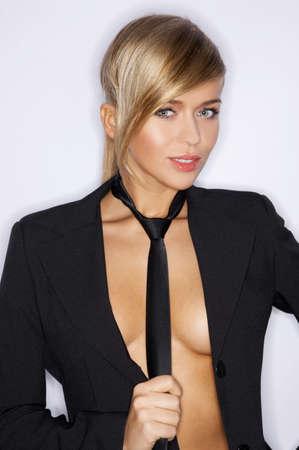 unbutton: Pretty Young Woman in Unbutton Black Coat and Tie
