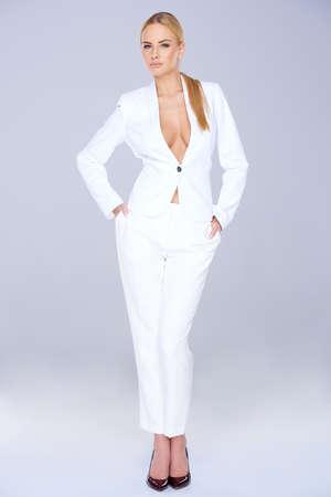 slack: Stylish slender woman in a white slack suit