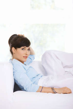 Young woman relaxing on a sofa photo