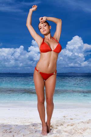 bikini island: Sexy young woman in a red bikini at the beach