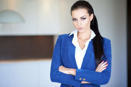 Confident Businesswoman in Blue Long Sleeve photo