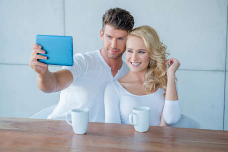 Young couple smiling for a selfie photo