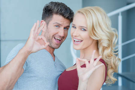20 24: Laughing happy couple making Perfect gestures Stock Photo