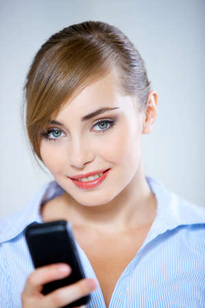 Pretty Smiling Woman Using Black Mobile Phone photo