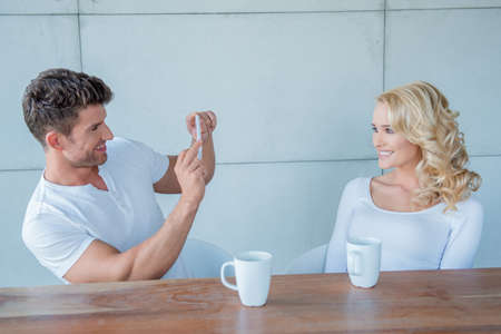 taking a wife: Man taking a photo of his beautiful blond wife Stock Photo