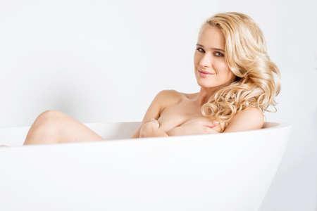 lying in bathtub: Gorgeous Caucasian Woman Inside White Bathtub