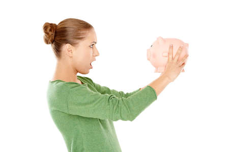 thrift box: Shocked Young Woman Facing Pink Piggy Bank
