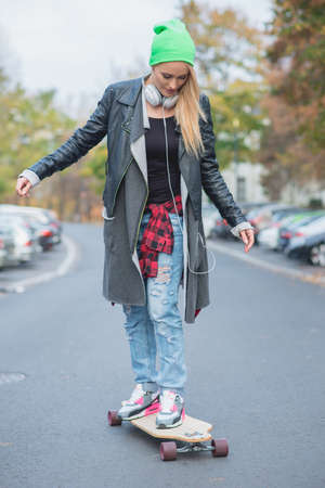 Young White Woman on Skateboard at the Street