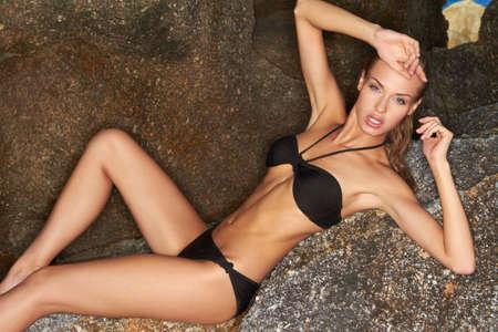 beautiful armpit: Sensual Slim Woman in Bikini Posing at Big Rocks