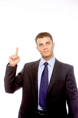 Businessman pointing above his head photo