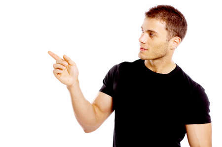 Handsome young man pointing to the side photo