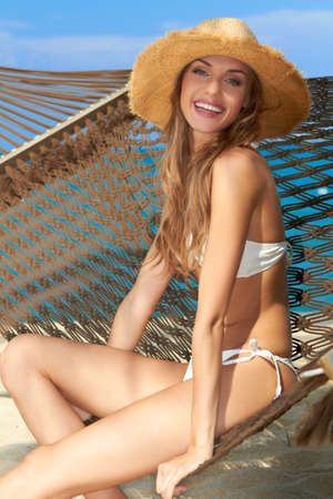 high spirited: Sexy slender woman relaxing on a hammock