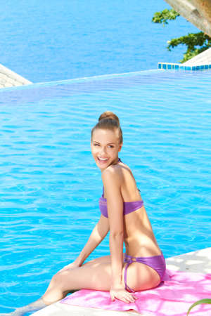 summer wear: Pretty Woman in Violet Summer Wear at the Poolside