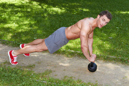 Athletic Young Man Exercising at the Park photo