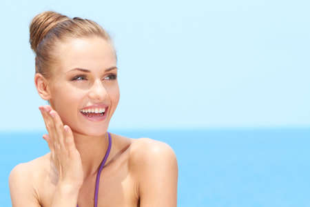 Happy Sexy Woman Looking at her Upper Left Side