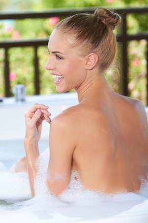 woman in bath: Happy woman enjoying a bubble bath