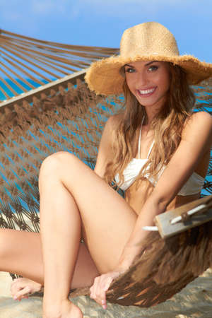 high spirited: Gorgeous blond woman relaxing in a hammock