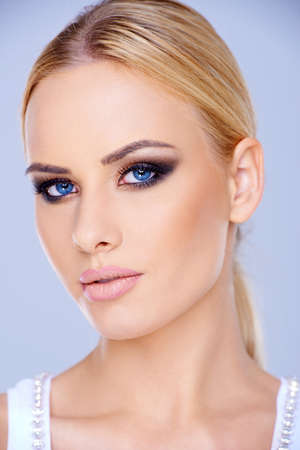 close up eyes: Close up Blond Woman with Blue Eyes Stock Photo