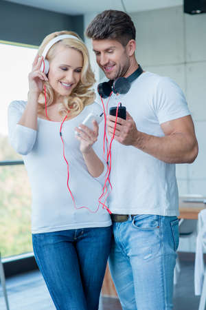 20 24: Happy Couple Listening Music from Phone
