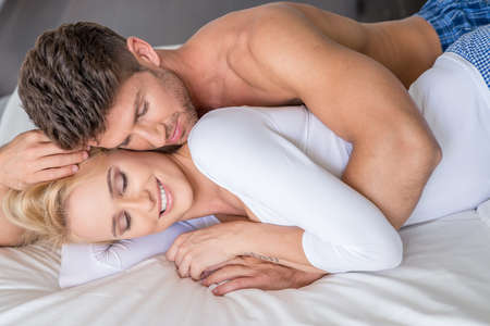 girl in love: Romantic Couple Lying on White Bed