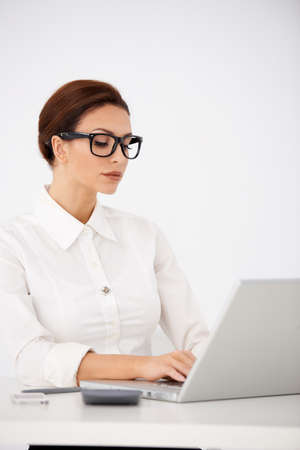 sensuous: Serious Office Woman Typing on Laptop