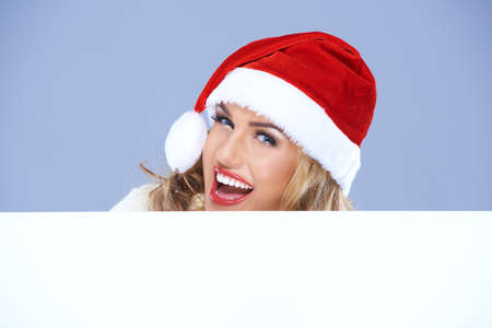 Laughing woman in a Santa hat with sign photo