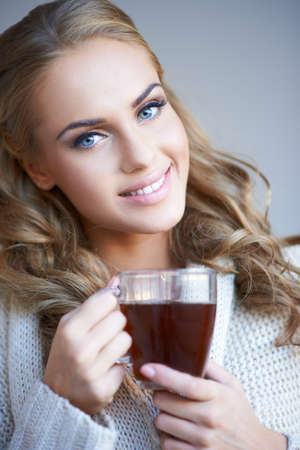 Smiling attractive woman with a mug of coffee photo