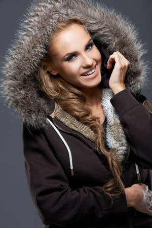 Happy Woman in Jacket with Furry Hood photo