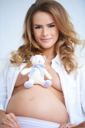 Pregnant mother with a gorgeous smile photo